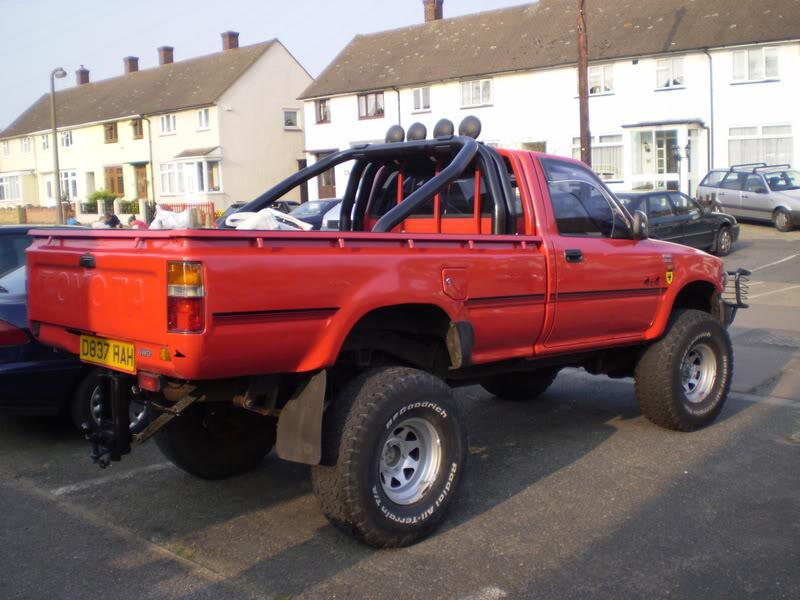 Name:  Red hilux with roll bar.jpg